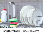 different clean plates in dish... | Shutterstock . vector #1228469395