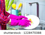 woman in rubber colored gloves... | Shutterstock . vector #1228470388