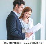 female contractor is showing... | Shutterstock . vector #1228483648