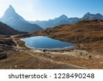 two mountainbikers in the last... | Shutterstock . vector #1228490248
