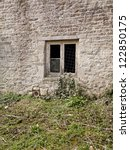 a broken window on an abandoned ... | Shutterstock . vector #122850175
