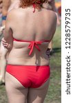 girl in a red bathing suit in... | Shutterstock . vector #1228579735