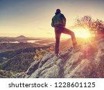 traveler on mountain summit... | Shutterstock . vector #1228601125