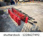red tank of fire extinguisher.... | Shutterstock . vector #1228627492