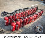 red tank of fire extinguisher.... | Shutterstock . vector #1228627495