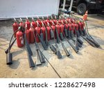 red tank of fire extinguisher.... | Shutterstock . vector #1228627498
