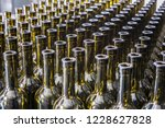 wine bottles background ...   Shutterstock . vector #1228627828