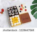 four spell mousse cake | Shutterstock . vector #1228667068