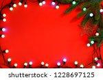 christmas lights on red... | Shutterstock . vector #1228697125