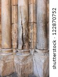Marble columns at the entrance to the Church of the Holy Sepulchere in Jerusalem .One of them  has a crack which is burned by sacred fire flame that miracle appears as the Holy Fire on Easter - stock photo