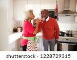 mature black couple celebrating ... | Shutterstock . vector #1228729315