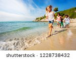 happy kids running one after... | Shutterstock . vector #1228738432