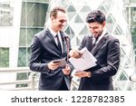 image two business partners in... | Shutterstock . vector #1228782385