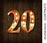 golden number 20 on a wooden... | Shutterstock .eps vector #1228796272