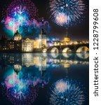 beautiful fireworks above... | Shutterstock . vector #1228799608