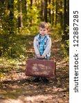 Sad Boy Holding Suitcase