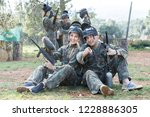 happy male and female paintball ... | Shutterstock . vector #1228886305