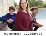 group of teenagers relaxing... | Shutterstock . vector #1228889338