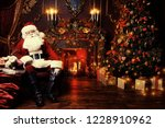 surprised santa claus in a... | Shutterstock . vector #1228910962