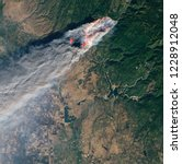 satellite view of the wildfires ... | Shutterstock . vector #1228912048