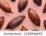 Cocoa Pods On A Pink Backgroun...