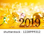 new year closeup golden 2019... | Shutterstock . vector #1228999312