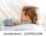 sleepy little toddler boy... | Shutterstock . vector #1229041108