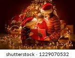 christmas family opening... | Shutterstock . vector #1229070532
