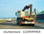 truck with crane on highway... | Shutterstock . vector #1229099905