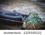 soldier fires a machine gun | Shutterstock . vector #1229105122
