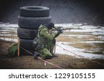 soldier shoots from a sniper... | Shutterstock . vector #1229105155