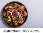 grilled chicken legs with...   Shutterstock . vector #1229123992