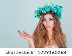 young surprised woman wearing... | Shutterstock . vector #1229160268