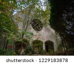 Small photo of Abandoned church in the woods on old British military barracks in Werl, Germany, falling apart and vandalized