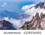 clouds by the mountain peaks of ... | Shutterstock . vector #1229226502
