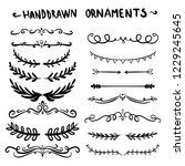 collection of handdrawn swirls... | Shutterstock .eps vector #1229245645