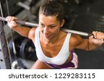 young girl workout at the gym | Shutterstock . vector #1229283115