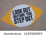 look out before you step sign... | Shutterstock . vector #1229285095