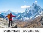 trekker standing at the edge of ... | Shutterstock . vector #1229380432