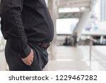 fat man belly. close up shot of ... | Shutterstock . vector #1229467282