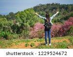 freedom traveler girl standing... | Shutterstock . vector #1229524672
