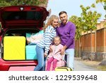 happy young family with... | Shutterstock . vector #1229539648