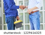 man thanks the repairman for... | Shutterstock . vector #1229616325
