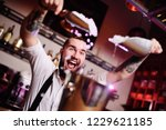the bartender at a party in a... | Shutterstock . vector #1229621185