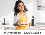 attractive african american... | Shutterstock . vector #1229623255
