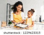 african american mother and... | Shutterstock . vector #1229623315