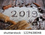 2019 text made with flour with... | Shutterstock . vector #1229638048