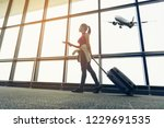 traveler women plan and... | Shutterstock . vector #1229691535
