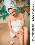 smiling girl applying scrub... | Shutterstock . vector #1229692192