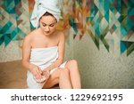 young woman holding scrub while ... | Shutterstock . vector #1229692195